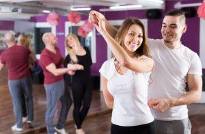 Couples having dancing class